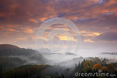 Czech typical autumn landscape. Hills and forest with foggy morning. Morning fall valley of Bohemian Switzerland park. Hills with