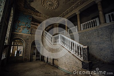 Inside of old creepy abandoned mansion. Staircase and colonnade