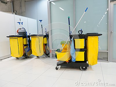 Cleaning Cart in the station. Cleaning tools cart and Yellow mop bucket wait for cleaning.Bucket and set of cleaning equipment