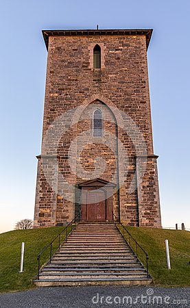 The medieval stone church at Avaldsnes, on the Island of Karmoy, Norway, vertical image of the front entrance and stairs