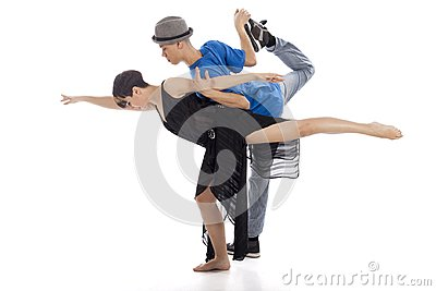 Two modern ballet dancers in dynamic action figure, on white bac