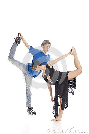 Two modern ballet dancers in dynamic action figure, on white background