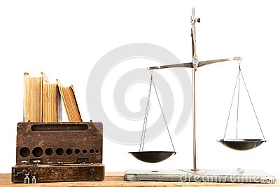 Old libra and stack of antique books isolated on white backgroun