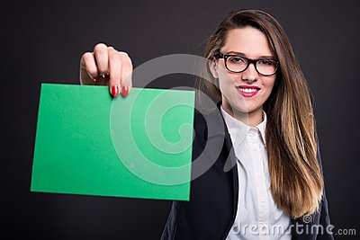 Woman holding blank paper with copyspace