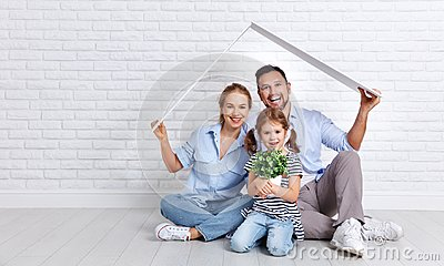 Concept housing young family. Mother father and child in new h