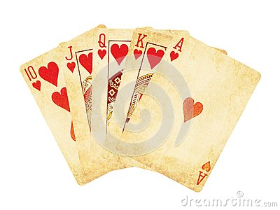 Vintage worn out hearts royal flush poker cards wooden table top