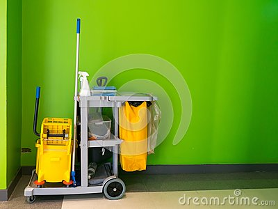 Cleaning tools cart wait for cleaning.Bucket and set of cleaning equipment in the office. janitor service janitorial for your plac