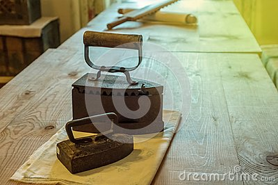 Flatiron two lie on the table cloth, 19th century Russian metal irons used by great-grandfathers