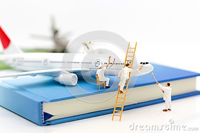 Miniature people: Group worker are repairing the plane. Image use for maintenance, Improvement, business concept