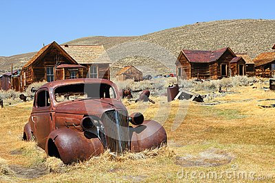 Bodie State Historic Park, California, USA - Arrested Decay of old car and houses at Bodie Ghost Town, Mono County