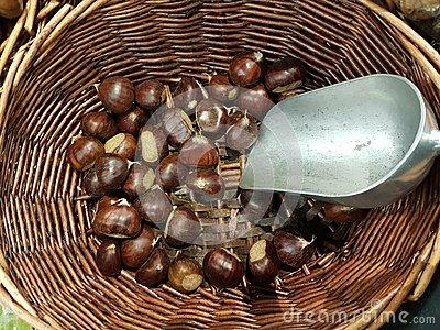Chestnuts in the basket bailer in market place food background