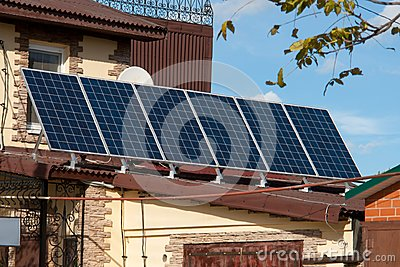 Solar energy panels on the roof of the house. aternative energy. Solar battery.