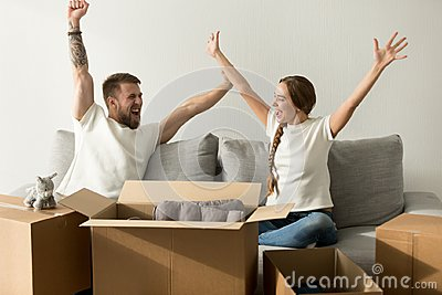 Excited couple glad to move into new home celebrating together