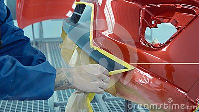 Car bumper after painting in a cars spray booth. Auto vehicle primer bumper.