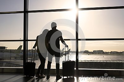 Couple waiting for flight in airport