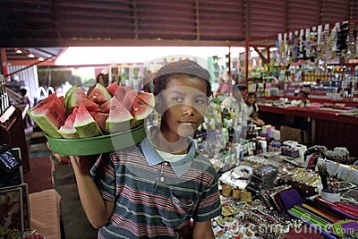 Portrait of Latino boy selling water melons
