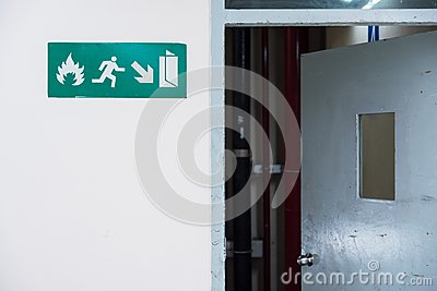Fire exit sign in the airport terminal emergency exit way.Thaila