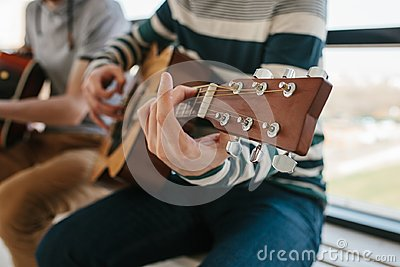 Learning to play the guitar. Music education and extracurricular lessons. Hobbies and enthusiasm for playing guitar and