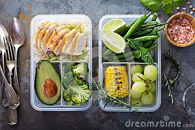 Healthy green meal prep containers with rice and vegetables