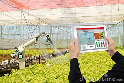 stock image of iot smart industry robot 4.0 agriculture concept,industrial agronomist,farmer using software artificial intelligence technology in