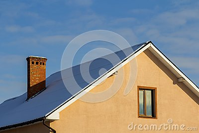 Roof of a new built house with nice window and chimney.