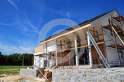 Unfinished house. Home Remodeling and Renovation. Painting house wall with stucco and plastering. Insulation House Wall