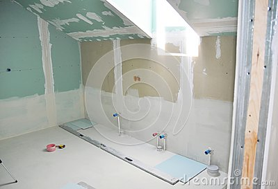 Remodeling attic bathroom with drywall repair, plastering painting, stucco. Bathroom repair and renovation