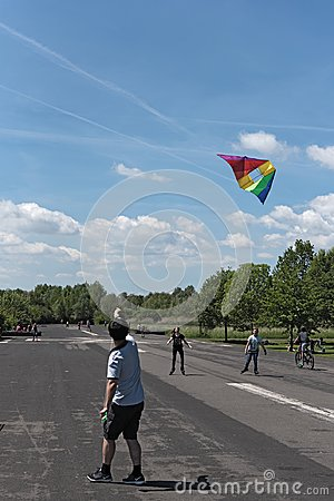 Boy makes a kite climb on the nature and recreation area. Old airfield in Frankfurt-Bonames