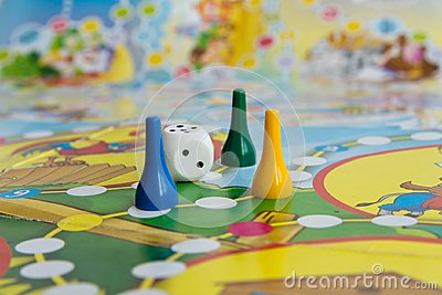 Blue, yellow and green plastic chips, dice and Board games for children
