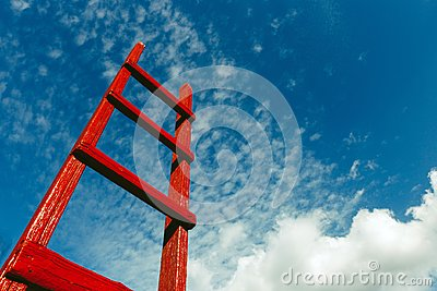 Red wooden staircase against the blue sky. Development Motivation Business Career Heaven Growth Concept