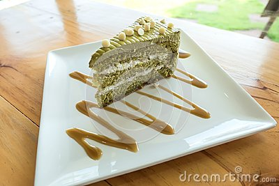 Closeup Japanese Matcha Green tea cake on a white plate on table