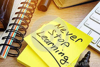 Never stop learning written on a stick. Lifelong learning concept.