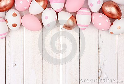 Easter egg top border. Rose gold, pink and white on white wood.