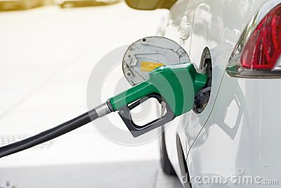 Refill and filling Oil Gas Fuel at station.Gas station - refueling.To fill the machine with fuel