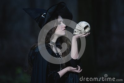 Witch with a skull