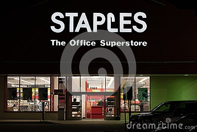 Staples office supply store entrance at night