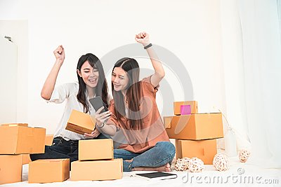 Two young Asian woman startup small business entrepreneur SME di