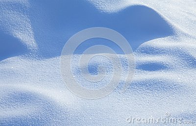 Beautiful snowy textured background, bluish colored snow abstract shape surface, close-up shallow depth of field