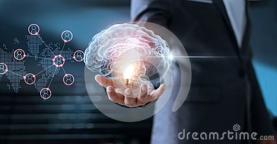 Businessman holding brain and light bulb with global networking