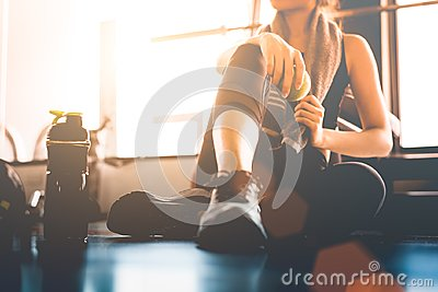 stock image of sport woman sitting and resting after workout or exercise in fit