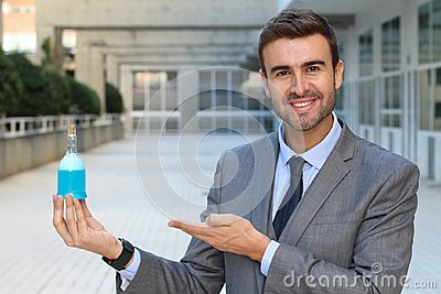 Handsome businessman holding a potion