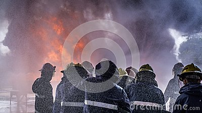Team of fire fighters was trained to extinguishing huge flame with water hydrant