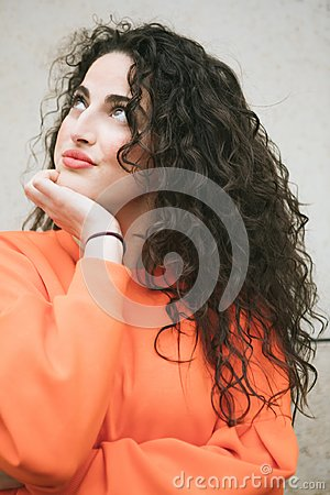 Dreamy girl with luxurious long voluminous hair. Attractive bright brunette portrait