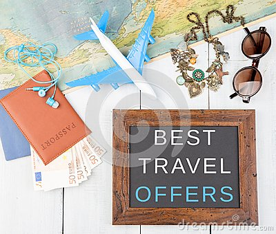 blackboard with text & x22;Best travel offers& x22;, plane, map, passport, money, sunglasses
