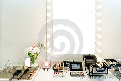 Modern closet room with make-up vanity table, mirror and cosmeti