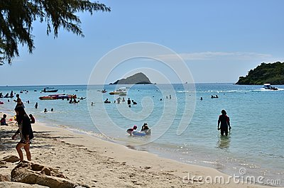 People relaxing on the beach.Tourists come and play the sea.