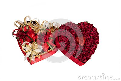 Valentine`s day mix of chocolates in the shape of hearts in the heart shaped box on white background