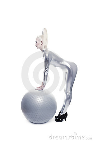 Woman standing with a silver ball