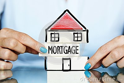 Release the mortgage of the property concept with young woman and house symbol on a table