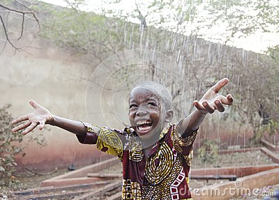 Sweet little African boy under the rain in Mali Africa